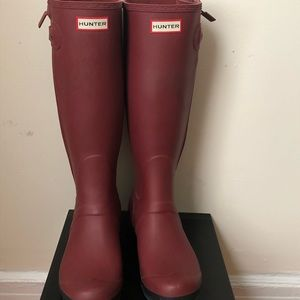 Slim fit hunter boots. Minor tear and wear